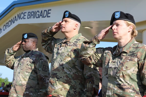 Brig. Gen. David Wilson (left), Maj. Gen. Paul C. Hurley (center) and Brig. Gen. Heidi J. Hoyle (right) render their salute to the Commander of Troops to begin the ceremony.