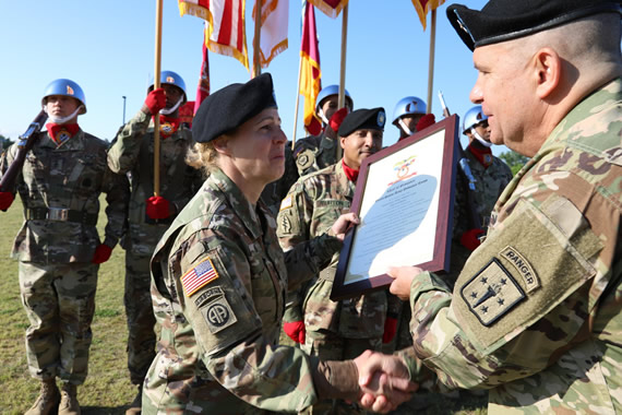 Brig. Gen. Hoyle receives a charter which outlines her responsibilities as the Chief of Ordnance.
