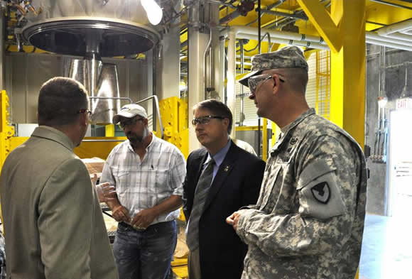 Left to right. Mr. Bill Tollett (Ammunition Operations Director),Mr. Jerry Lovell (Explosive Supervisor), Mr. Moore (CASCOM DCG), COL Joseph Dalessio (MCAAP Commander), Mr. Tollett is explaining the new B-Line Explosive Fill