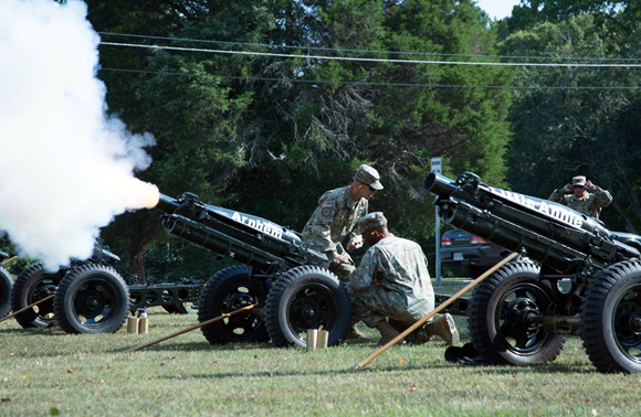 U.S. Army Sgt. Jerome Pacis, and Staff Sgt. Isaac Gresham fire a 75mm howitzer salute at Fort Pickett, VA., Aug 6 2017.<br>(U.S. Army photo by Spc. Jordan Buck)