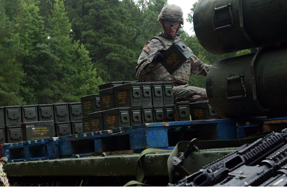 A U.S. Soldier moves an ammo can during the Ordnance Crucible at Fort Pickett, Va. Aug 7, 2017.<br> 