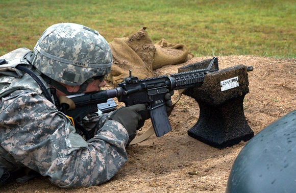 U.S. Armt Cpt Joshua Smith fires a M4 Carbine at the Ammunition Transfer Holding Point(ATHP) defend site in Fort Pickett, VA. Aug 8, 2017<br>