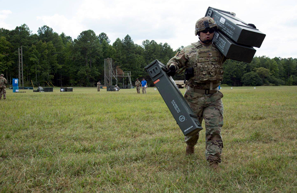 U.S. Army Sgt Eduardo Cataln transfers ammunition at the Ammunition Transfer Hold Point Operations event at Fort Pickett, VA. Aug 9, 2017<br>