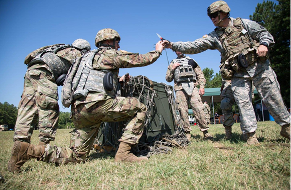 U.S. Soldiers secure ammunition cans at the Sling Load event during the Ordnance Crucible at Fort Pickett, VA. Aug 10, 2017<br>