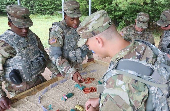 U.S. Soldiers participate in the Ammo Transfer Holding Point event during the Ordnance Crucible at Fort Pickett, VA. Aug 8, 2017<br>