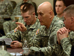 Army Chief of Staff Gen. Ray Odierno provides his feedback to two groups of captains who were discussing the role advanced cognitive abilities play for Soldiers fighting in increasingly complex environments during Solarium 2015 at the Command and General Staff College on Fort Leavenworth, Kan., Feb. 24-26, 2015. (Photo Credit: David Vergun)