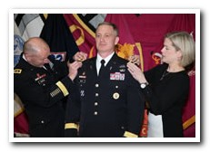 "Brig. Gen. John F. ""Jack"" Haley receives his first star as Lt. Gen. Edward C. Cardon, U.S. Army Cyber Command commanding general, left, and Jennifer Haley pin on his new rank during the Jan. 24 promotion ceremony. Haley is the 38th Chief of Ordnance and Ordnance School commandant."