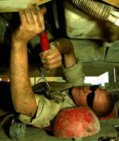 Ordnance Soldier fixing a vehicle